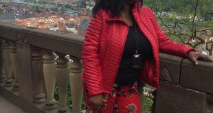 Annita standing on balcony